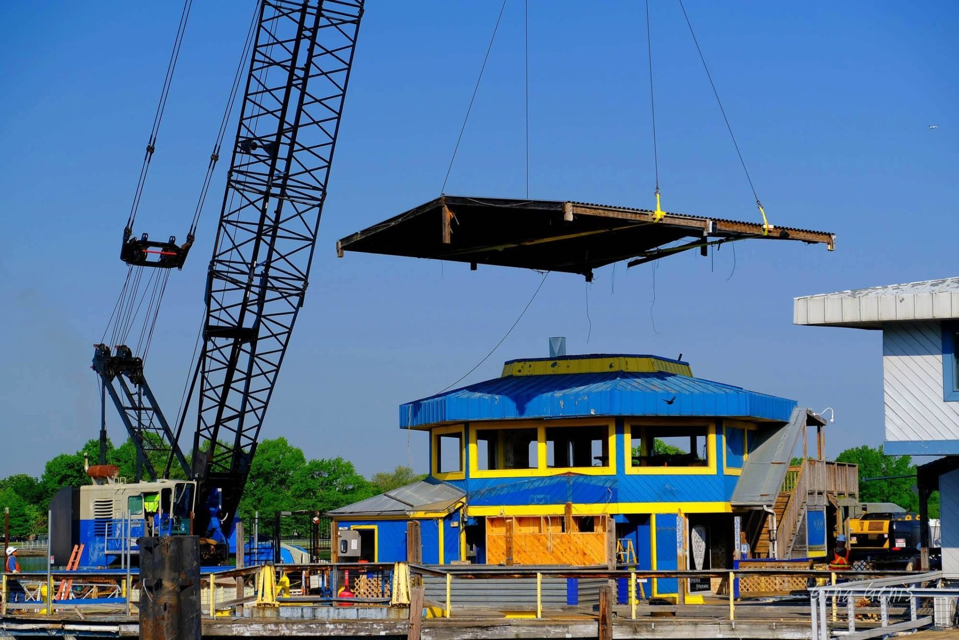 Demo teams lift the roof of the Cantina Marina up and away on Tuesday, May 8 2018. (Courtesy Gina Genis)