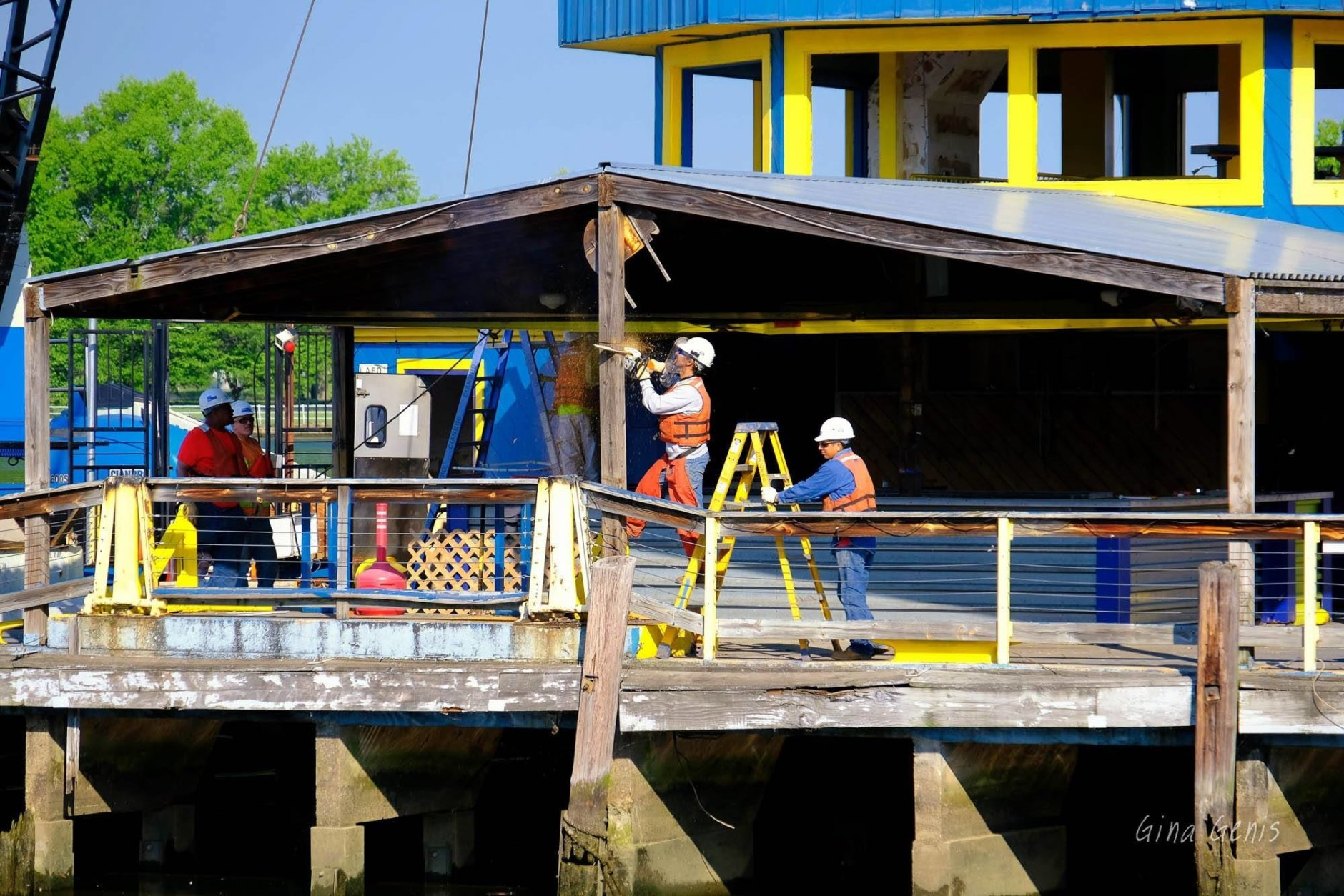 Workers saw the roof support beams at the Cantina Marina on Tuesday, May 8 2018. (Courtesy Gina Genis)