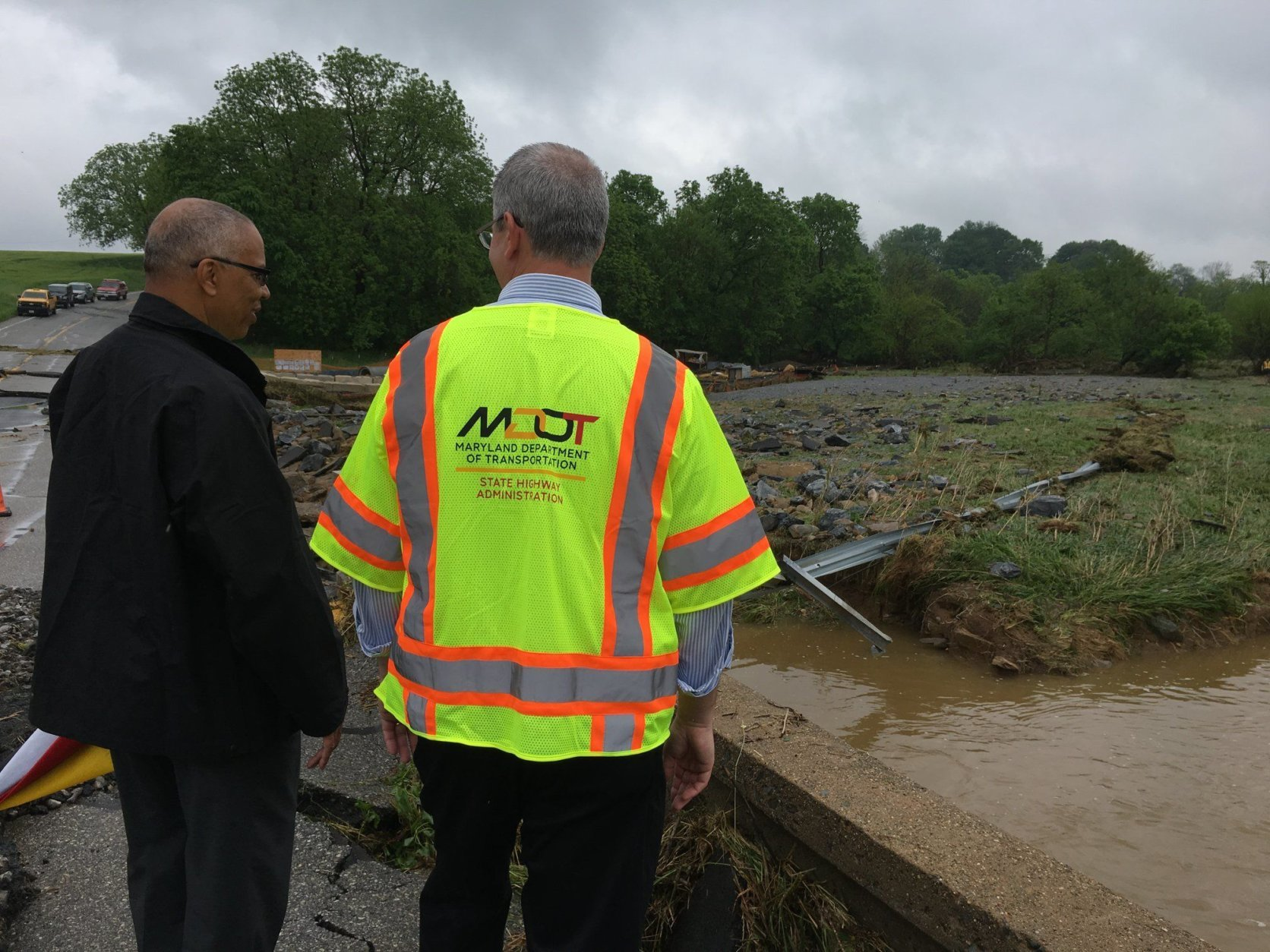 Maryland Lt. Governor Boyd Rutherford with a representative from State Highway Administration evaluate flood damage in Frederick and Washington counties. (Courtesy Boyd Rutherford)