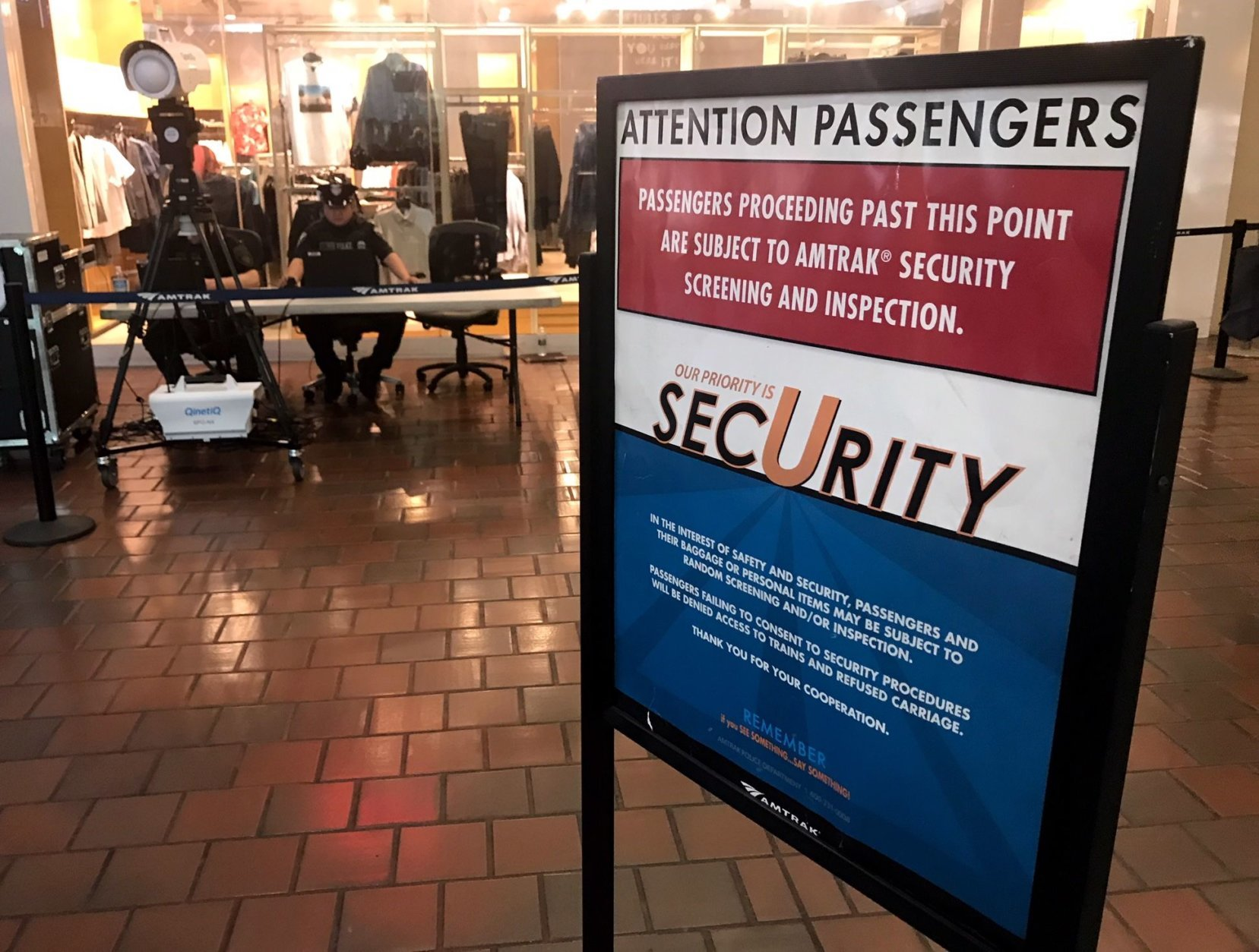 In a crowded corridor, passengers and shoppers walked by new portable screening equipment, which was being tested by Amtrak police, working with the Transportation Security Administration.(WTOP/Neal Augenstein)
