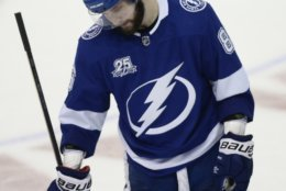 Tampa Bay Lightning right wing Nikita Kucherov skates back to his bench after the Washington Capitals scored a goal during the third period of Game 7 of the NHL Eastern Conference finals hockey playoff series Wednesday, May 23, 2018, in Tampa, Fla. (AP Photo/Jason Behnken)