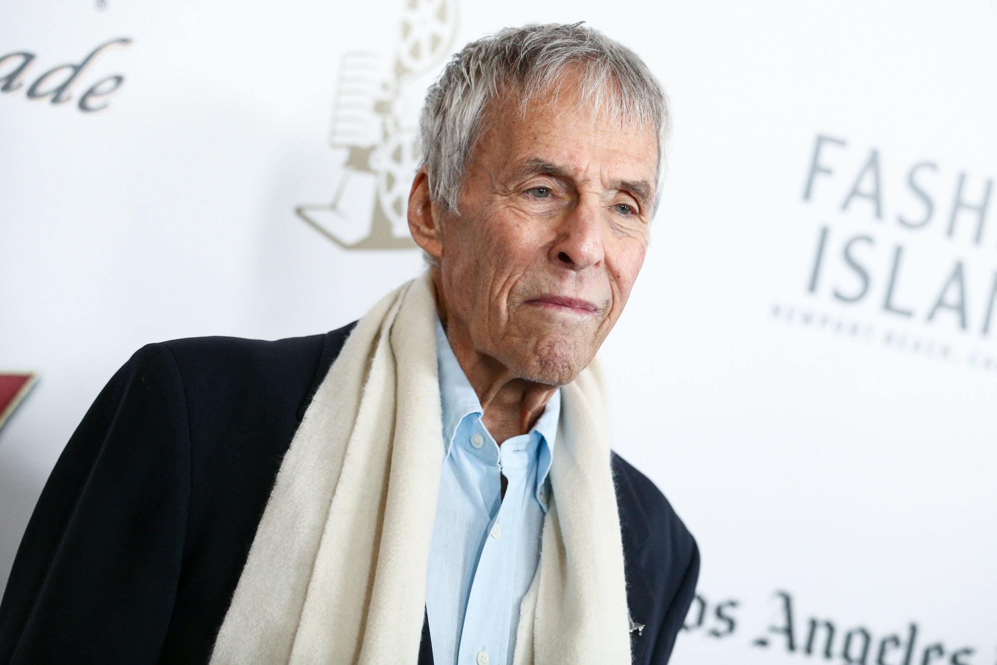 FILE - In this April 23, 2016 file photo, Burt Bacharach attends the 2016 Newport Beach Film Festival Honors in Newport Beach, Calif. Bacharach is canceling two September concerts to recover from a broken arm. A spokeswoman for the 88-year-old composer and conductor said Tuesday that Bacharach will skip scheduled performances on Sept. 3 in Curacao and Sept. 17 in Lancaster, California. Publicist Tina Brausam said Bacharach plans to resume his touring schedule in October. (Photo by John Salangsang/Invision/AP, File)
