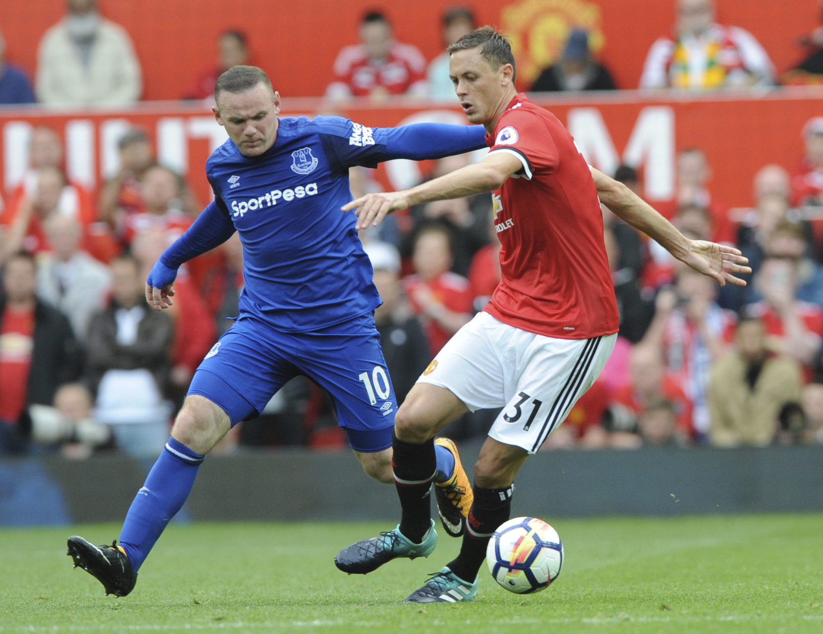 Everton's Wayne Rooney, left, and Manchester United's Nemanja Matic battle for the ball during the English Premier League soccer match between Manchester United and Everton at Old Trafford in Manchester, England, Sunday, Sept. 17, 2017. (AP Photo/Rui Vieira)