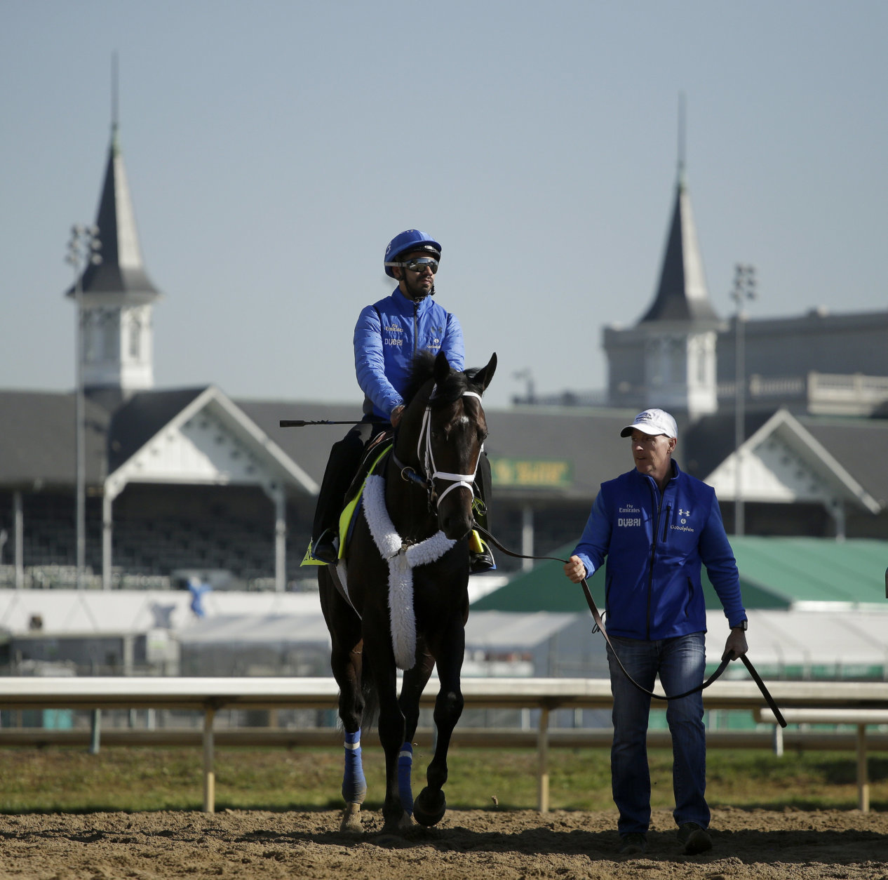 Kentucky Derby hopeful Enticed is led off the track after a morning workout at Churchill Downs Tuesday, May 1, 2018, in Louisville, Ky. The 144th running of the Kentucky Derby is scheduled for Saturday, May 5. (AP Photo/Charlie Riedel)