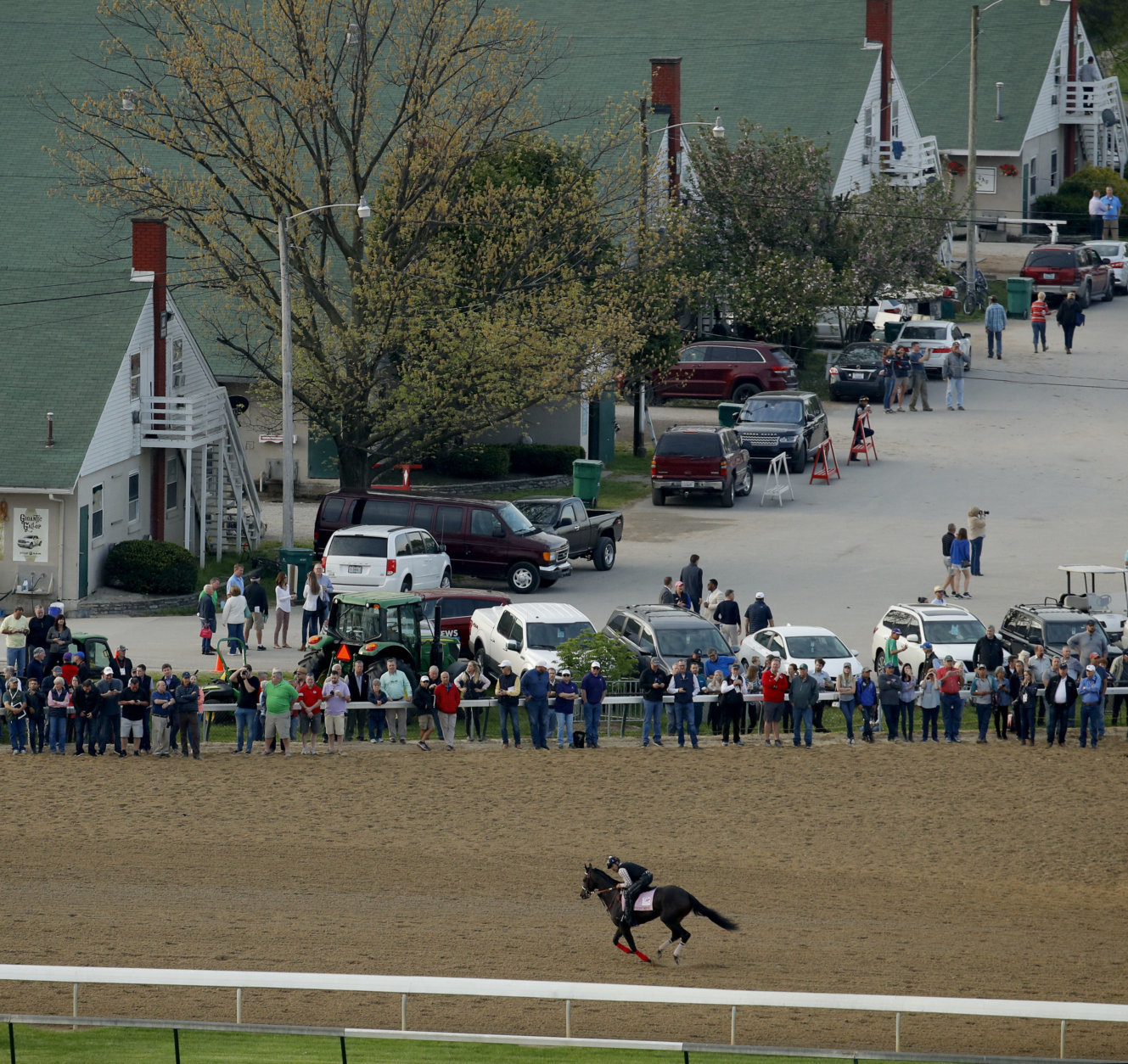Kentucky Oaks entrant Midnight Bisou runs during a morning workout for Oaks and Kentucky Derby entrants at Churchill Downs Wednesday, May 2, 2018, in Louisville, Ky. The 144th running of the Kentucky Derby is scheduled for Saturday, May 5. (AP Photo/Charlie Riedel)