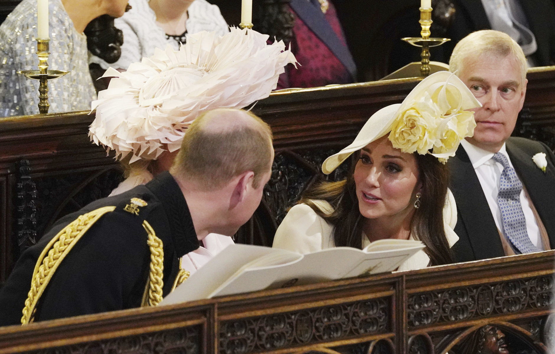 From left, Britain's Prince William, Kate Duchess of Cambridge and Prince Andrew during the wedding service of Prince Harry and Meghan Markle at St. George's Chapel in Windsor Castle in Windsor, near London, England, Saturday, May 19, 2018. (Jonathan Brady/pool photo via AP)