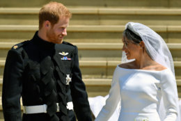Prince Harry and Meghan Markle walk down the steps after their wedding at St. George's Chapel in Windsor Castle in Windsor, near London, England, Saturday, May 19, 2018. (Ben Birchhall/pool photo via AP)