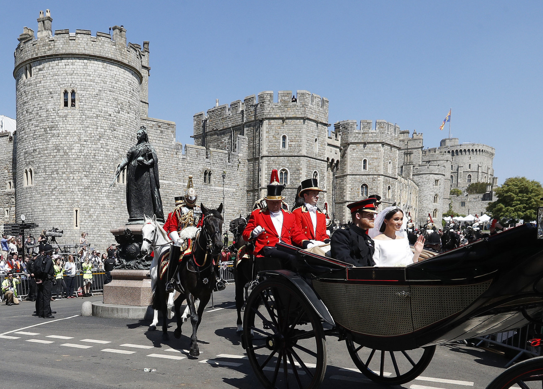 Britain's Prince Harry and Meghan Markle, right, leave Windsor Castle in a carriage after their wedding ceremony at St. George's Chapel in Windsor Castle in Windsor, near London, England, Saturday, May 19, 2018. (AP Photo/Frank Augstein, pool)