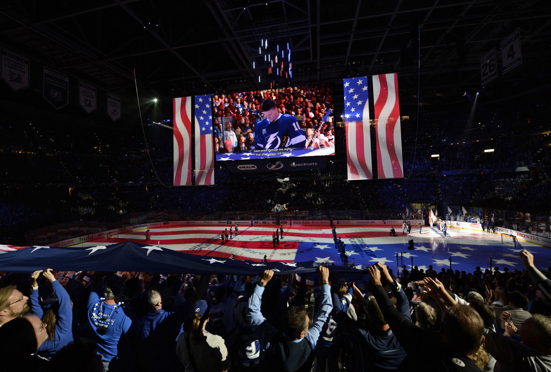 Fans cheer before Game 7 of the NHL Eastern Conference finals hockey playoff series between the Tampa Bay Lightning and the Washington Capitals Wednesday, May 23, 2018, in Tampa, Fla. (AP Photo/Jason Behnken)