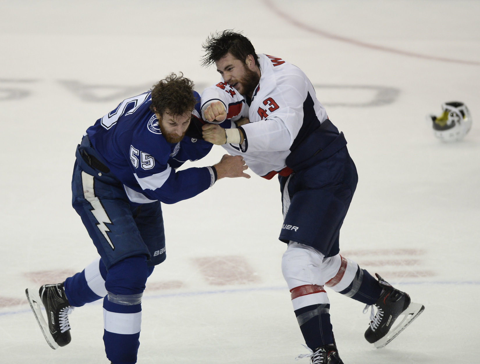 Tampa Bay Lightning defenseman Braydon Coburn (55) and Washington Capitals right wing Tom Wilson (43) fight during the first period of Game 7 of the NHL Eastern Conference finals hockey playoff series Wednesday, May 23, 2018, in Tampa, Fla. (AP Photo/Jason Behnken)