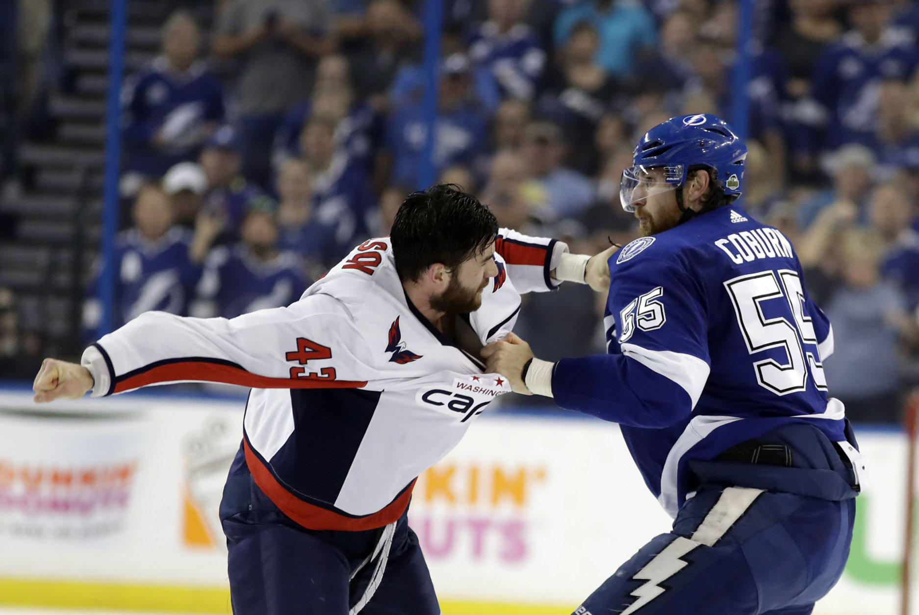 Tampa Bay Lightning defenseman Braydon Coburn, left, and Washington Capitals right wing Tom Wilson (43) fight during the first period of Game 7 of the NHL Eastern Conference finals hockey playoff series Wednesday, May 23, 2018, in Tampa, Fla. (AP Photo/Chris O'Meara)