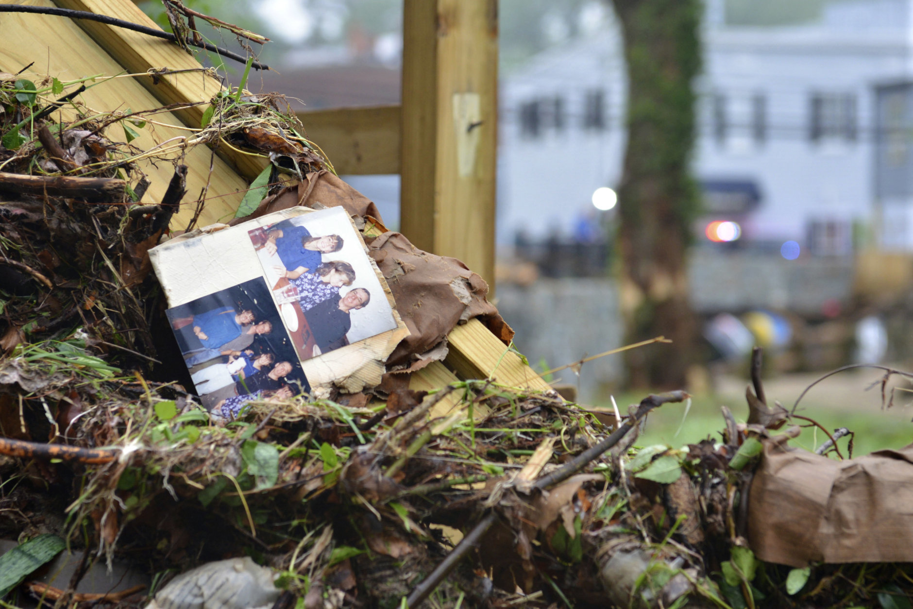 Family photos rest among debris after flash flooding in Ellicott City, Md., Monday, May 28, 2018. Sunday's destructive flooding left the former mill town heartbroken as it had bounded back from another destructive storm less than two years ago. (AP Photo/David McFadden)