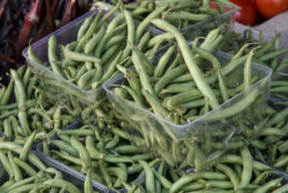 Fresh green beans, tomatoes, okra and other summer garden vegetables are displayed for sale at a farmers market in Falls Church, Va., Saturday, Aug. 1, 2015.  (AP Photo/J. Scott Applewhite)