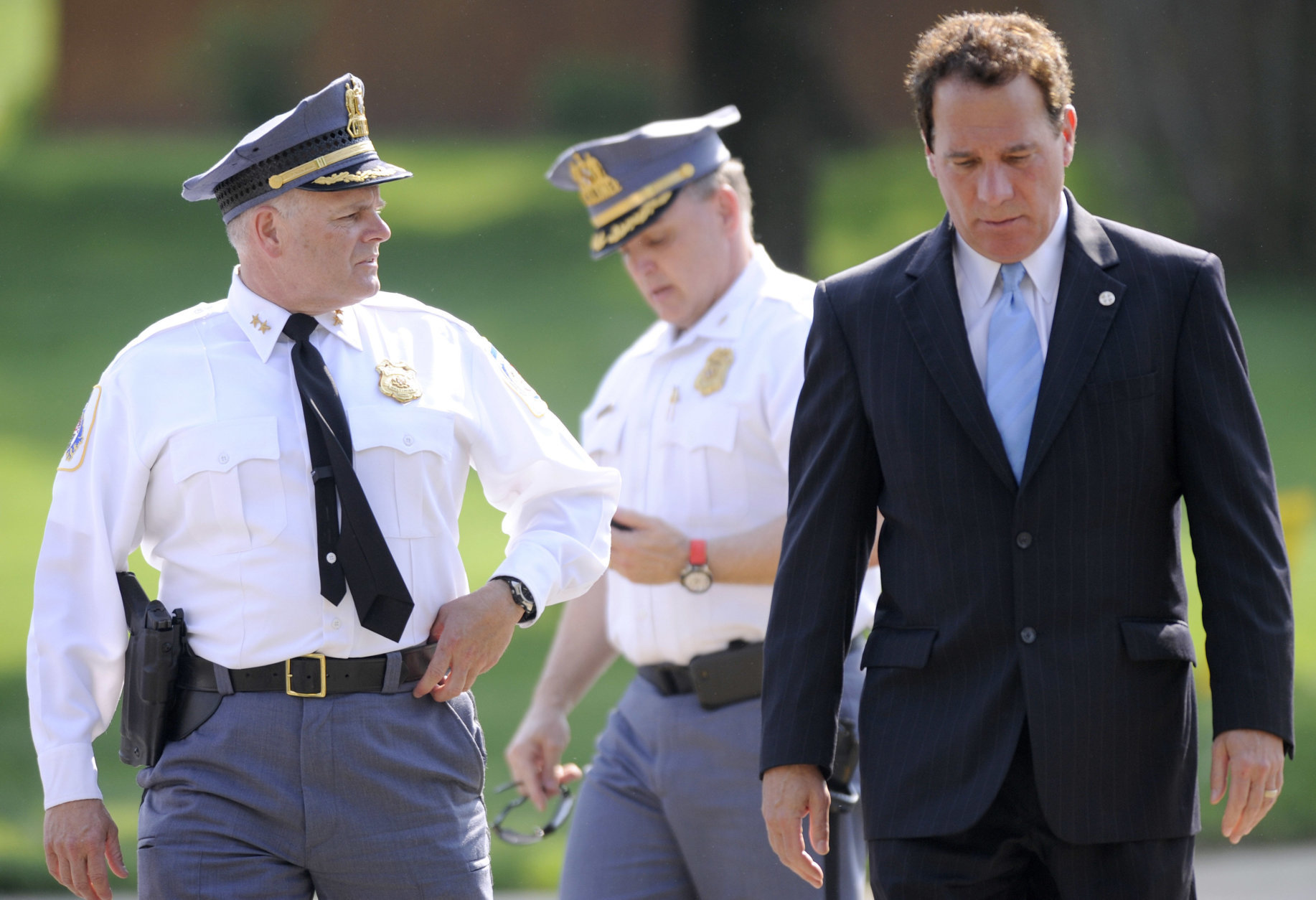 From left, Baltimore County Police Chief Jim Johnson, Baltimore County Police Col. Peter Evans and Baltimore County Executive Kevin Kamenetz arrive for a news conference outside WMAR-TV Tuesday, May 13, 2014, in Towson, Md. The officials announced that a man was taken into custody after allegedly crashing a vehicle into the television station. (AP Photo/Steve Ruark)