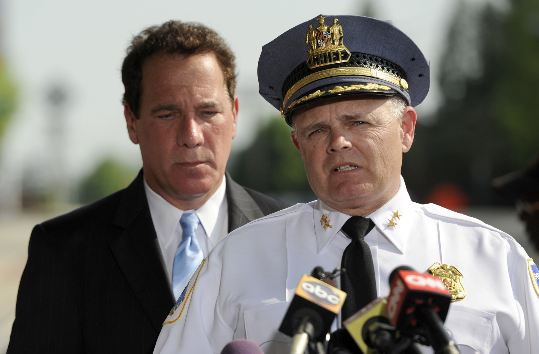 Baltimore County Police Chief Jim Johnson, right, speaks as Baltimore County Executive Kevin Kamenetz listens during a news conference outside WMAR-TV Tuesday, May 13, 2014, in Towson, Md. The officials announced that a man was taken into custody after allegedly crashing a vehicle into the television station. Kamenetz died of cardiac arrest at age 60 Thursday, May 10, 2018. (AP Photo/Steve Ruark)