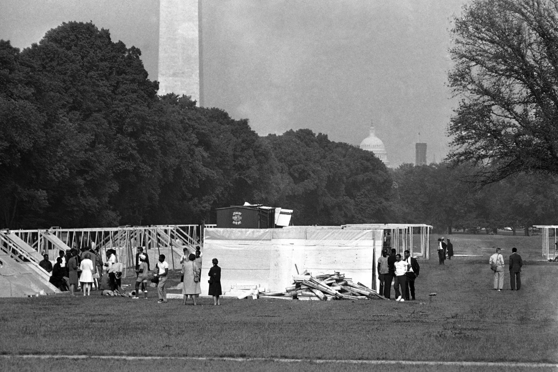Workmen set up flooring and A-frames for the wooden camp near Lincoln Memorial to house the Poor People's Campaign demonstrators in Washington, May 13, 1968. A federal permit allows the demonstrators to occupy the 15-acre area until on June 16 and limits occupants to 3,000. In background is the Washington Monument. (AP Photo/Bob Schutz)