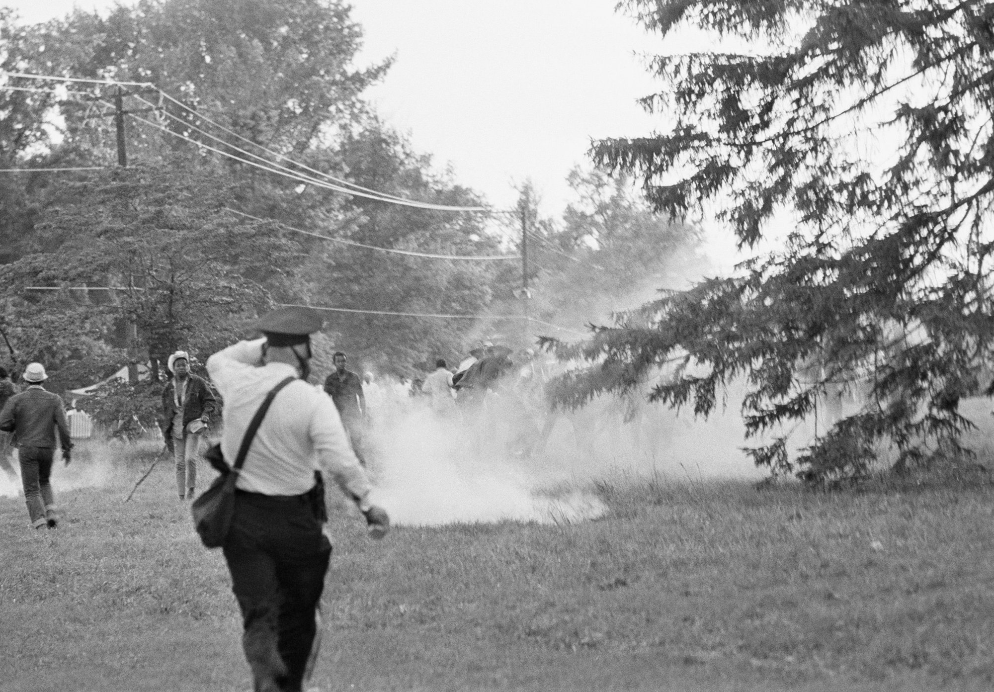 "Poor People's demonstrators run from tear gas used by police late on June 20, 1968 in Washington, near the campaign's  ""Resurrection City"" encampment.    Witnesses reported the  group became unruly when returning to the encampment from a demonstration at the Department of Agriculture. (AP Photo/Charles Harrity)"