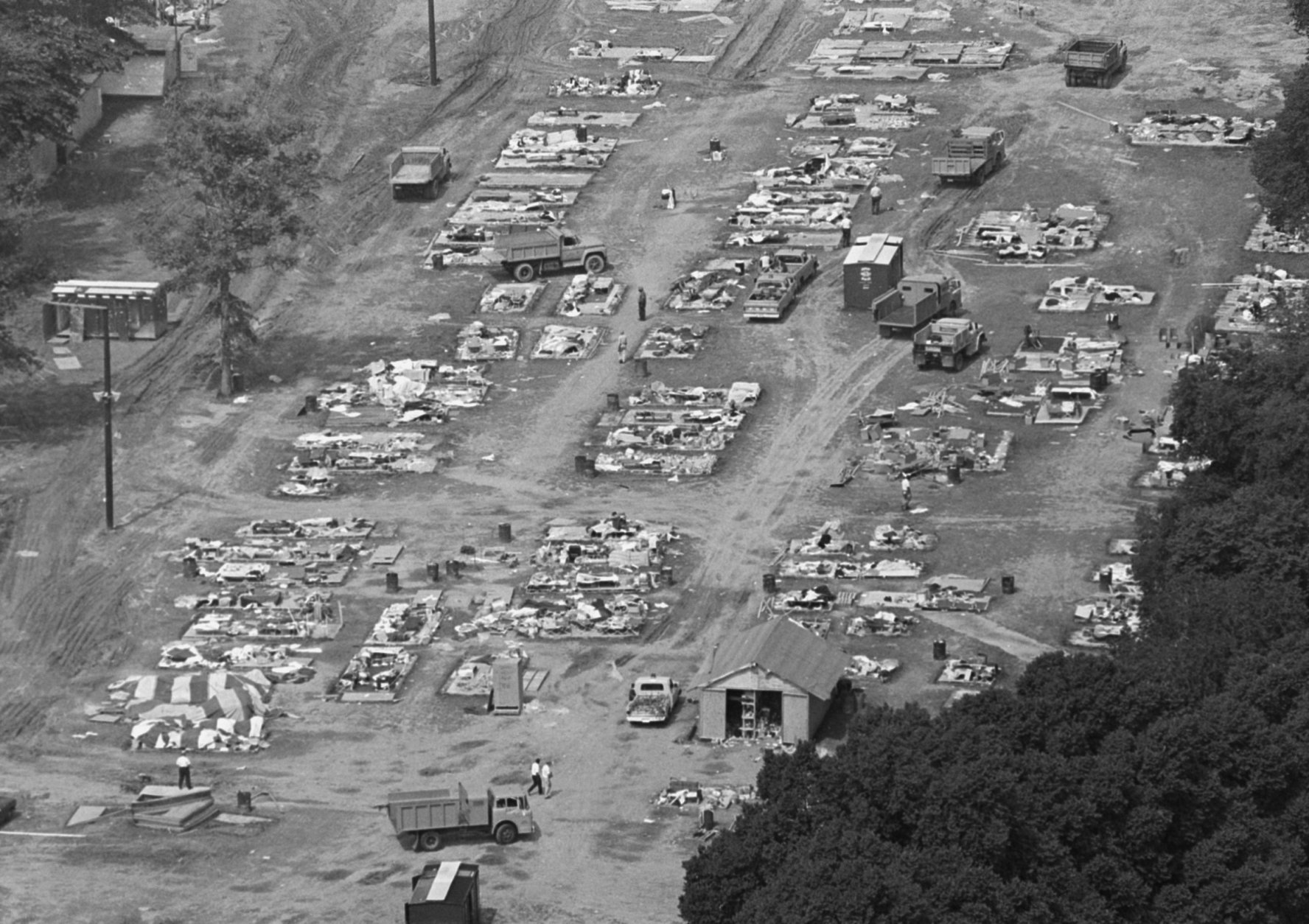 Resurrection City, the campsite of the Poor People's Campaign, is being rapidly dismantled on June 25, 1968 and removed from public land it occupies in Washington, D.C.   This is a view of the scene from the top of the Washington Monument,  June 25, 1968.   Only the floors of its many plywood shanties and some personal belongings of its former occupants remain. (AP Photo/Bob Daughtery