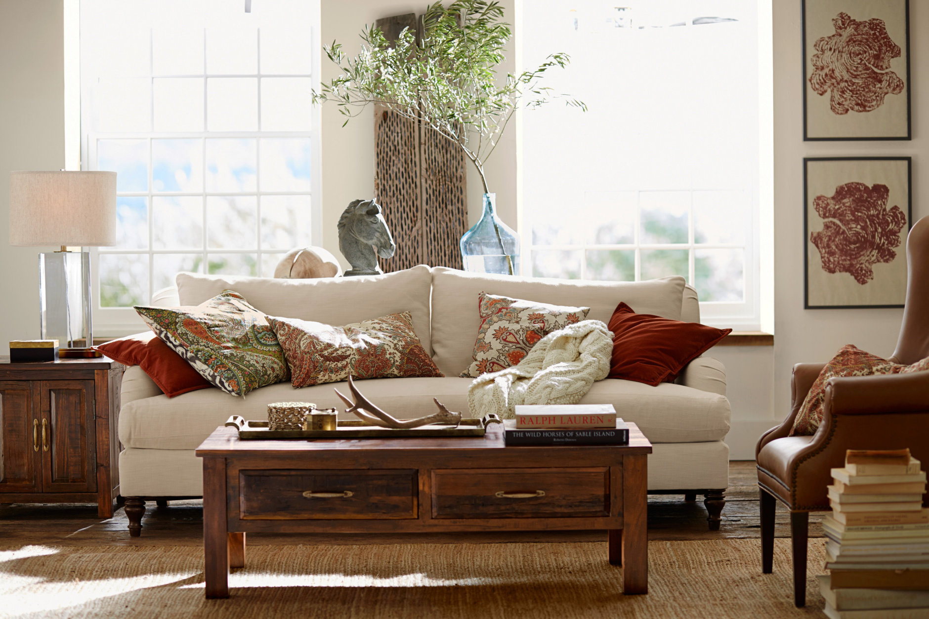 This photo provided by Pottery Barn shows a reclaimed wood coffee table in a living room that is part of the new Bowry collection. Each piece is made of reclaimed wood, which is an increasingly popular material for furniture. (Pottery Barn via AP)