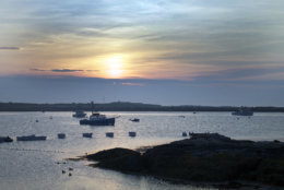 In this photo taken June 25, 2013 the sun rises over the Isles of Shoals taken from Star Island in Rye, N.H. Since the English explorer Captain John Smith spotted the islands just under 400 years ago, the cluster of nine small islands, five in Maine, four in New Hampshire, have evolved from rough-and-tumble 17th century fishing outpost to posh Victorian-era vacation destination. (AP Photo/Holly Ramer)