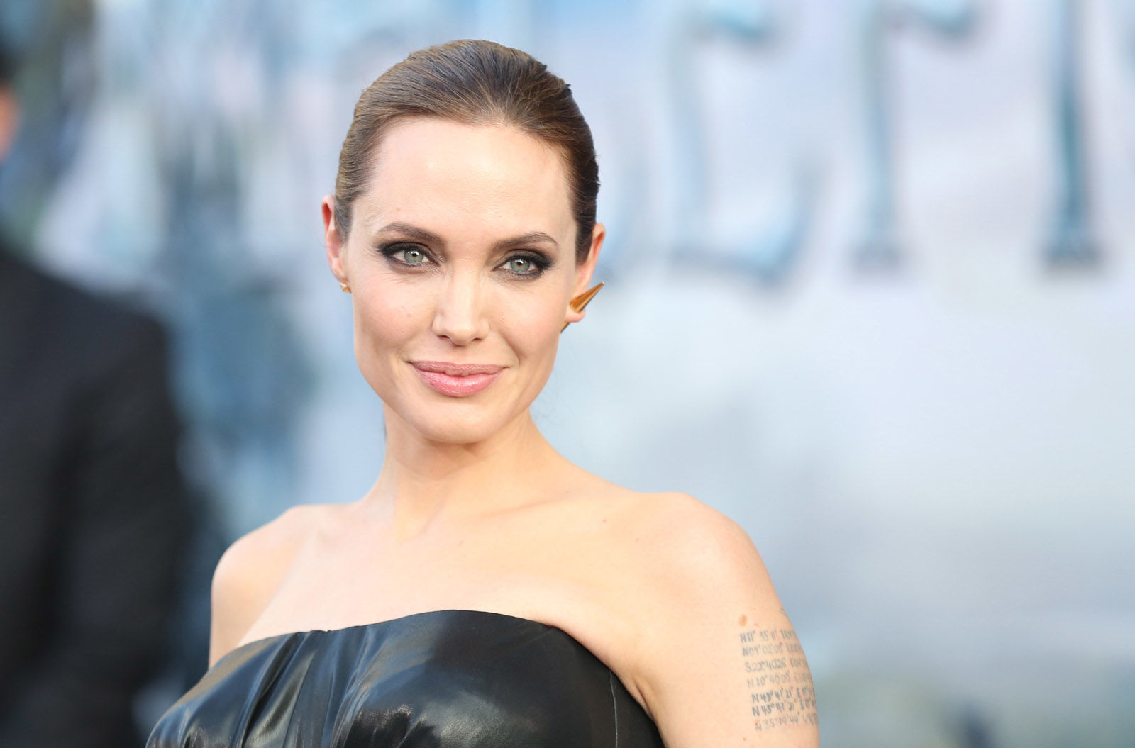 """Angelina Jolie arrives at the world premiere of """"Maleficent"""" at the El Capitan Theatre on Wednesday, May 28, 2014, in Los Angeles.  (Photo by Matt Sayles/Invision/AP)"""