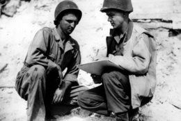 """Pvt. Robert L. Bowman, left, of Hogansville, Ga., poses for Stars and Stripes artist Sgt. Bill Mauldin, on the Anzio beachhead in Italy during World War II in May, 1944.  The completed picture will be known as """"G.I. Joe.""""  (AP Photo)"""