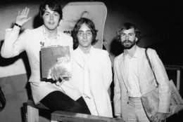 John Lennon, center, and Paul McCartney, left, member of the famed Beatles, announce in New York on May 14, 1968 that Beatles Ltd. is being reorganized for bigger things as Apple Corps. Ltd. (AP Photo)