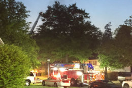 Crews try to put out a fire that killed one person in Beltsville, Maryland, on Saturday, May 12. (WTOP/John Domen)