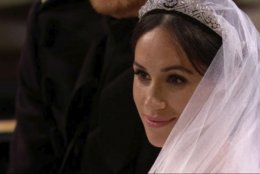 In this frame from video, Meghan Markle listens during her wedding ceremony with Britain's Prince Harry at St. George's Chapel in Windsor Castle in Windsor, near London, England, Saturday, May 19, 2018.  (UK Pool/Sky News via AP)