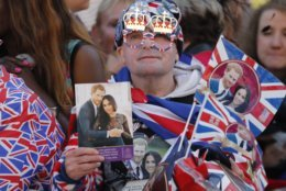 A Royal fan waits for the wedding ceremony of Prince Harry and Meghan Markle at St. George's Chapel in Windsor Castle in Windsor, near London, England, Saturday, May 19, 2018. (AP Photo/Frank Augstein)