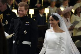 Britain's Prince Harry and Meghan Markle smile during their wedding ceremony in St. George's Chapel in Windsor Castle in Windsor, near London, England, Saturday, May 19, 2018. (Jonathan Brady/pool photo via AP)