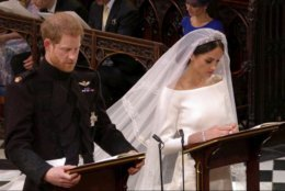 In this frame from video, Britain's Prince Harry and Meghan Markle pray during their wedding ceremony at St. George's Chapel in Windsor Castle in Windsor, near London, England, Saturday, May 19, 2018.  (UK Pool/Sky News via AP)