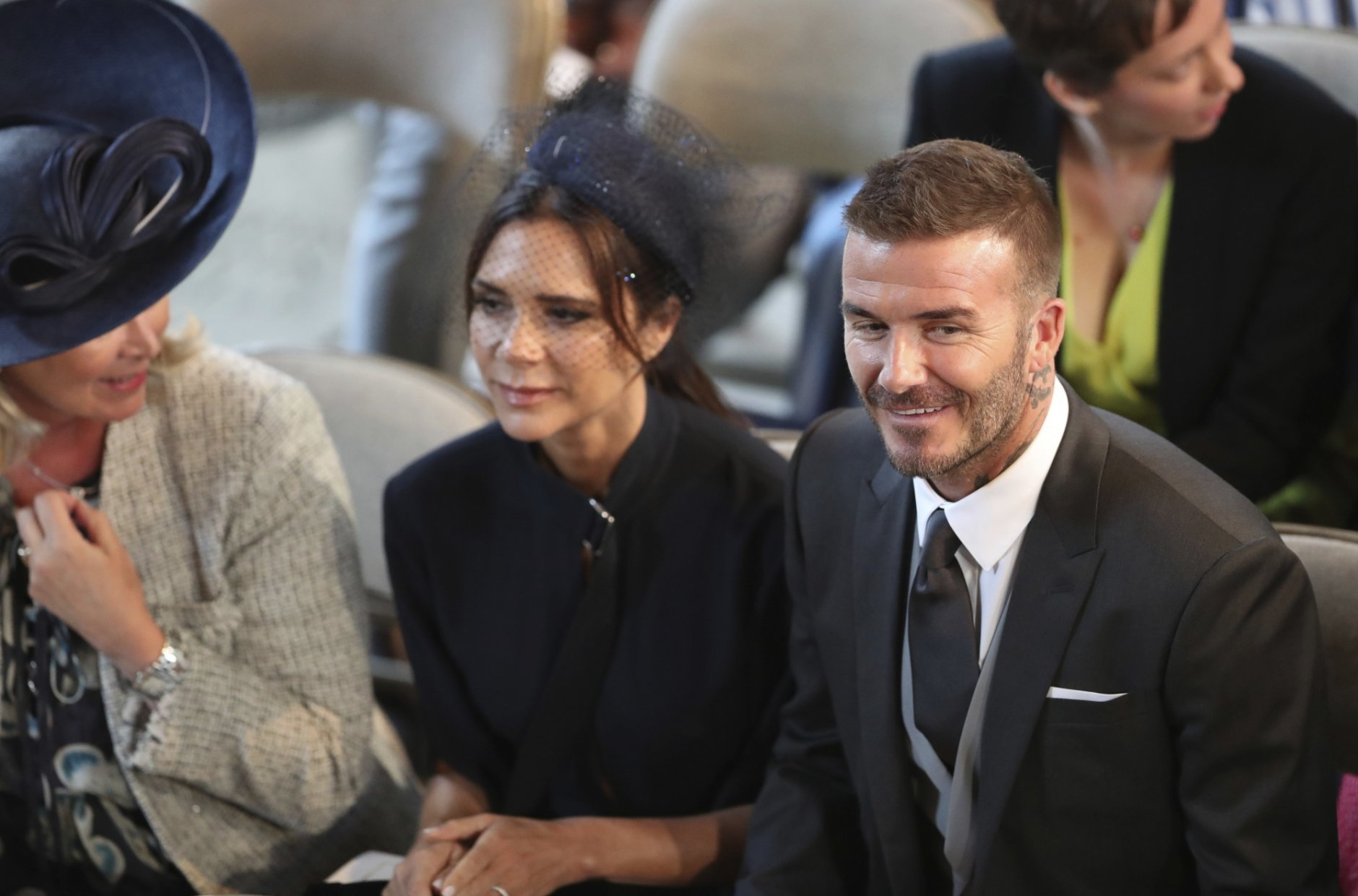 David and Victoria Beckham take their seats for the wedding of Prince Harry and Meghan Markle St. George's Chapel in Windsor Castle in Windsor, near London, England, Saturday, May 19, 2018. (Danny Lawson/pool photo via AP)