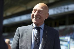 Huddersfield fan Patrick Stewart smiles before the English Premier League soccer match between Huddersfield Town and Arsenal at the John Smith's Stadium, Huddersfield, England, Sunday, May 13, 2018. (Mike Egerton/PA via AP)