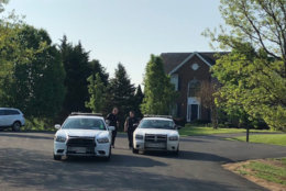 As of 8:25 a.m. on Tuesday, police were still on the scene of a triple murder in Brookeville, Maryland in Montgomery County. (WTOP/Melissa Howell)