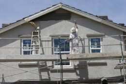 A house under construction is painted Friday, May 4, 2018, near Roseville, Calif. Federal data released Friday shows California has surpassed the United Kingdom to become the world's fifth largest economy, with real estate and financial services leading other economic sectors in driving the state's economic growth. (AP Photo/Rich Pedroncelli)