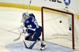 A shot by Washington Capitals' Alex Ovechkin goes past Tampa Bay Lightning goaltender Andrei Vasilevskiy  for a goal during the first period of Game 7 of the NHL hockey playoffs Eastern Conference finals Wednesday, May 23, 2018, in Tampa, Fla. (AP Photo/Jason Behnken)