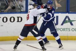 Washington Capitals defenseman Dmitry Orlov, left, loses his stick as he goes against Tampa Bay Lightning center Steven Stamkos, right, during the second period of Game 7 of the NHL Eastern Conference finals hockey playoff series Wednesday, May 23, 2018, in Tampa, Fla. (AP Photo/Jason Behnken)