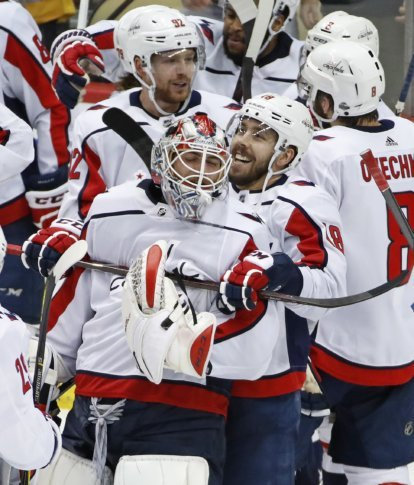 ... a hug from Chandler Stephenson (18) during a celebration following the  game-winning goal by Evgeny Kuznetsov (92) during the overtime period in Game  6 ... 6121203bf850