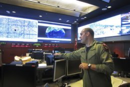In this Thursday, May 10, 2018 photo, Royal Canadian Air Force Col. Travis Morehen speaks in the North American Aerospace Defense Command command center inside Cheyenne Mountain, Colo. The U.S. military dug tunnels into the mountain in the 1960s for the command center to protect it from nuclear attack. The facility is now a backup for the main command center at Peterson Air Force Base in nearby Colorado Springs. The North American Aerospace Defense Command or NORAD is a U.S.-Canada command that monitors the skies over both nations. It is celebrating its 60th anniversary on May 12, 2018. (AP Photo/Dan Elliott)