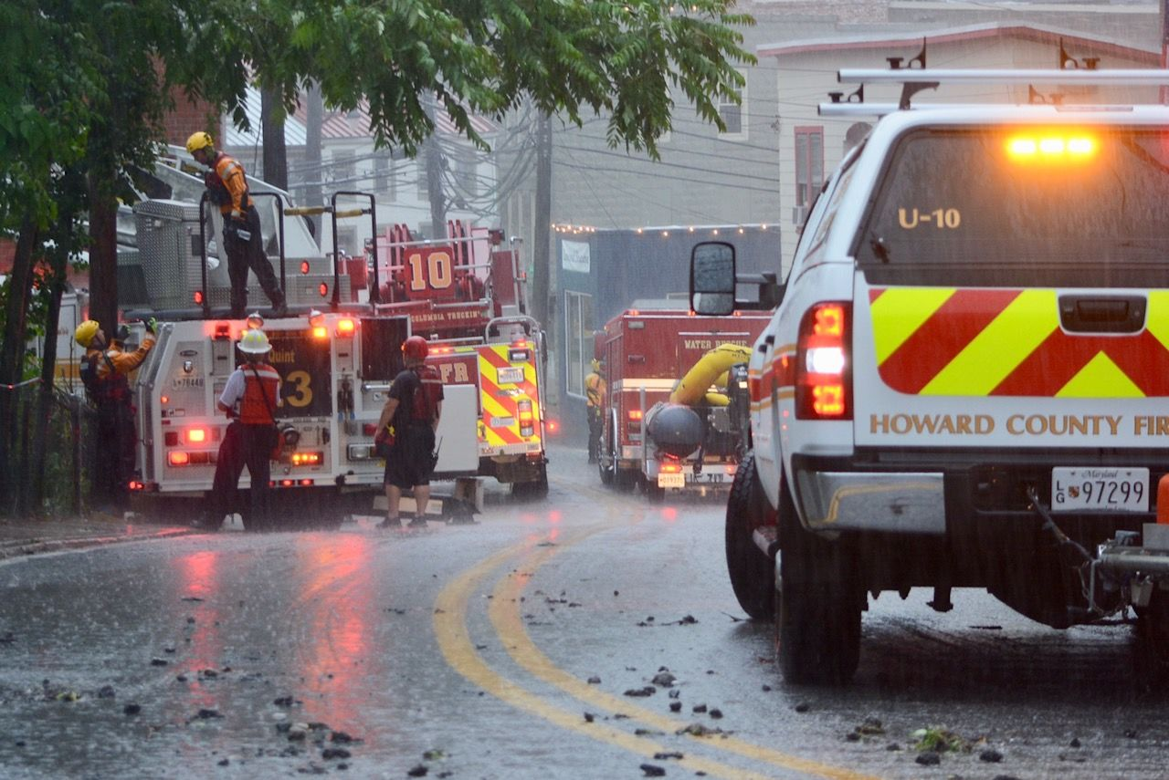 Emergency crews inspect an area during in Ellicott City on Sunday, May 27, 2018. (WTOP/Dave Dildine)