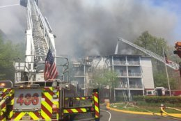 Crews fight flames at the Forest Glen Senior Apartments in the 14400 block of Woodmere Court in Centreville Wednesday afternoon. (Courtesy Fairfax County Fire and Rescue)