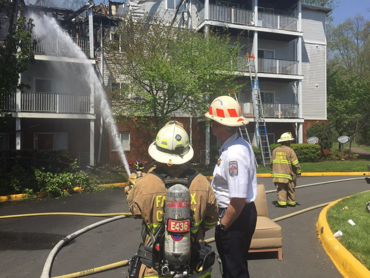 Fire crews work to extinguish the fire in the 14400 block of Woodmere Court in Centreville Wednesday afternoon. (Courtesy Fairfax County Fire and Rescue)