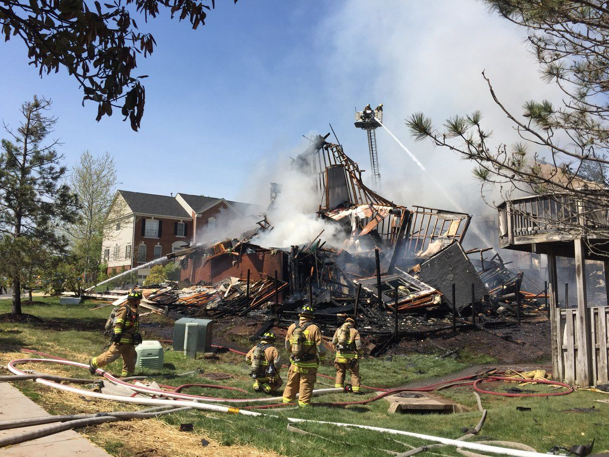 Fire crews extinguish hotspots at the fire in the 5800 block of Watermark Circle in Centreville Wednesday afternoon. (Courtesy Fairfax County Fire and Rescue)