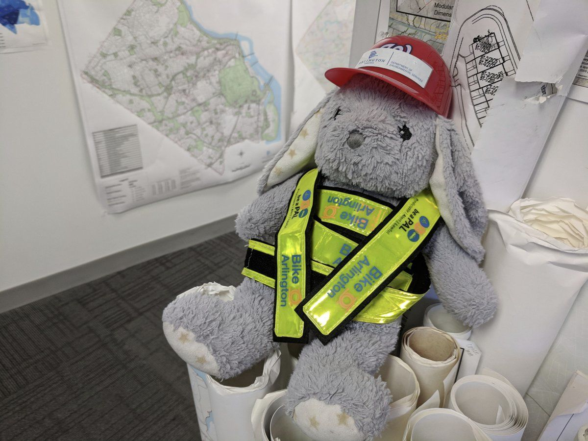 """Three days later, and despite """"tremendous"""" community support in the search, Arlington DES tweeted a photo of the bunny in protective gear in the county's GIS Mapping Center. (Photo courtesy of Arlington DES Twitter)"""