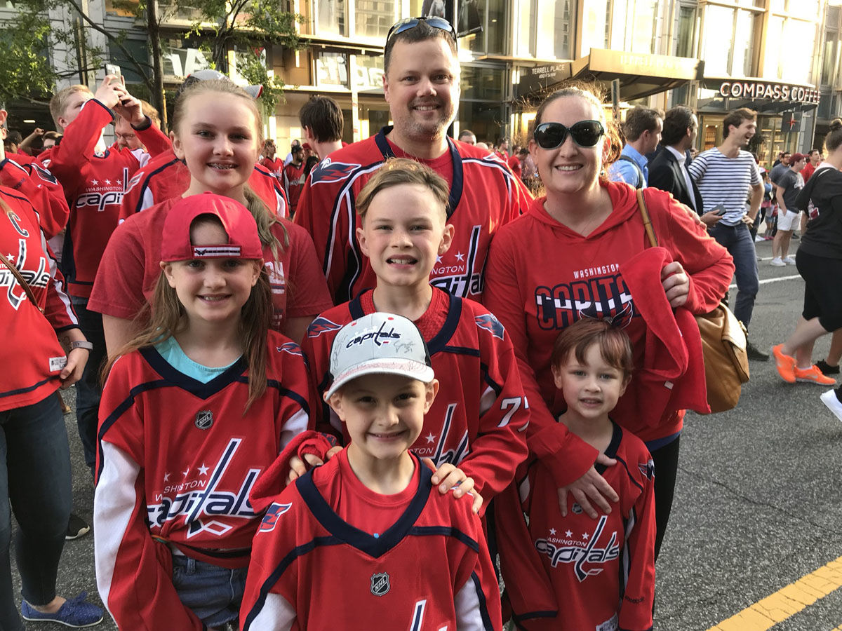 Fans rock the red in Washington, D.C. as the Washington Capitals face the Tampa Bay Lightning in Game 7 on Wednesday, May 23, 2018. (WTOP/Michelle Basch)