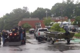 Maryland Natural Resources police stand by at the courthouse in Ellicott City, Md., with boats and ATVs for any potential water rescues on Sunday, May 27, 2018. (WTOP/Ralph Fox)