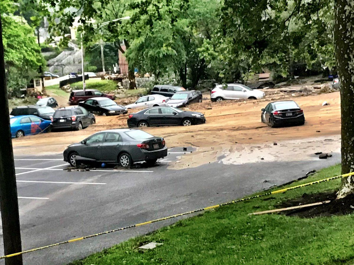 Flood waters dragged some cars out to a lot next to a portion of Ellicott Mills Drive. (WTOP/Neal Augenstein)