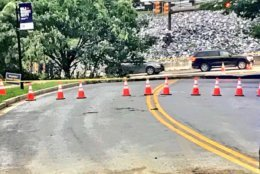 Twenty five feet of what was Ellicott Mills Drive is missing. (WTOP/Neal Augenstein)