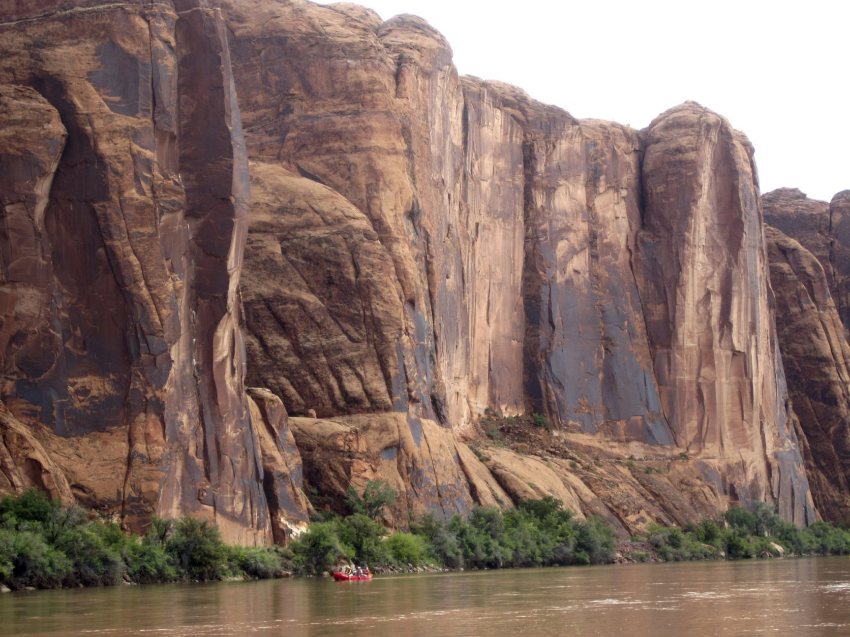FILE - In this July 25, 2017, file photo, rafters float down the Colorado River near Moab, Utah. Rivers are drying up, popular mountain recreation spots are closing and water restrictions are in full swing as a persistent drought intensifies its grip on pockets of the American Southwest. Climatologists and other experts are scheduled Wednesday, May 23, 2018, to provide an update on the situation in the Four Corners region - where Arizona, New Mexico, Colorado and Utah meet. (AP photo/Dan Elliott, File).